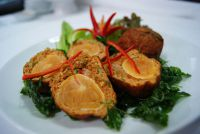 Deep-fried stuffed spicy fish cakes with salted egg